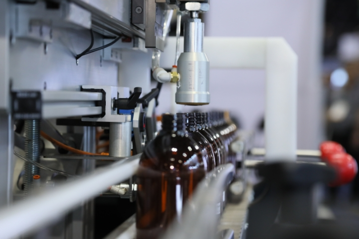 Machine manufacturing bottles in the bottle zone.