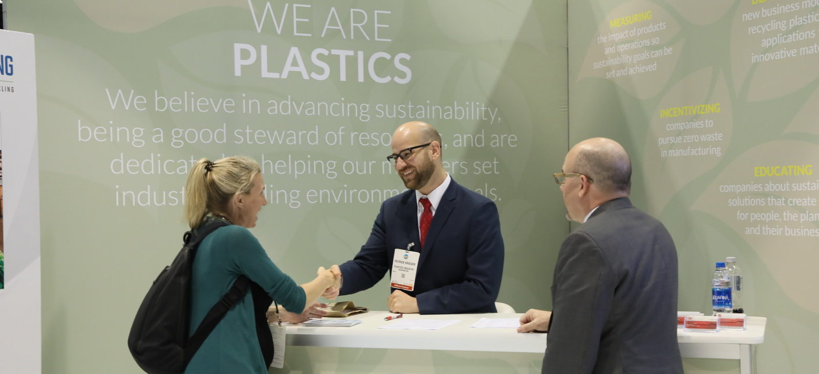 We are PLASTICS welcoming an attendee to the show floor.