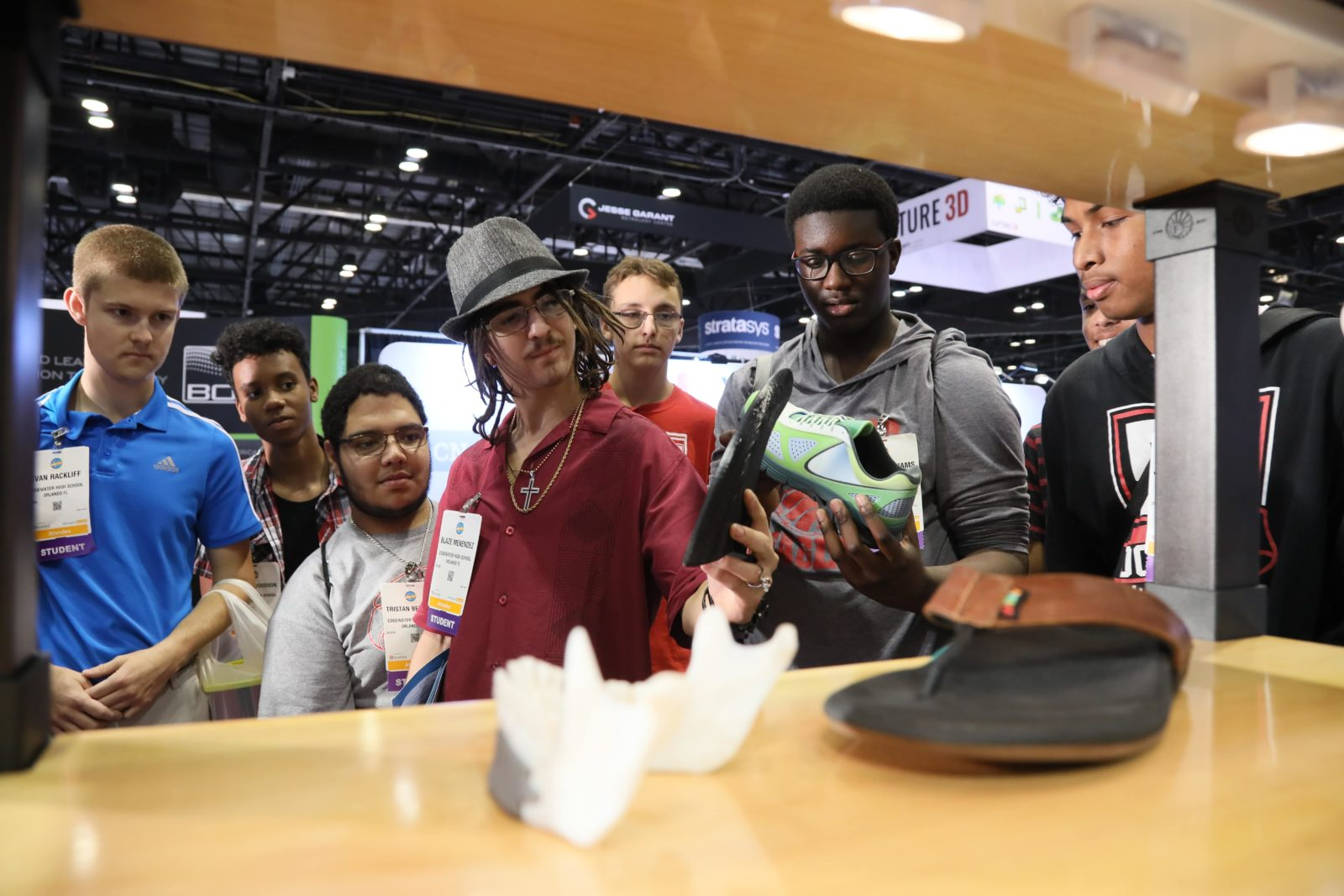 A group looks at an exhibit in the 3D/4D Printing zone